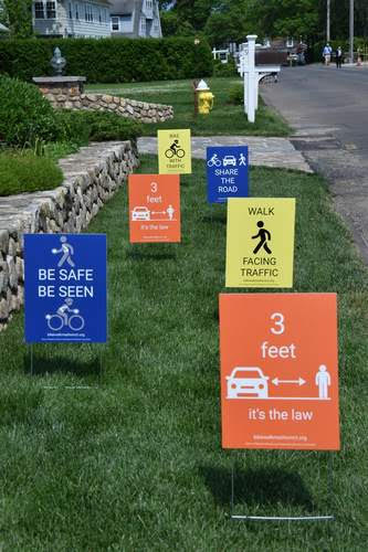 Sample safety signs- Be safe, be seen, 3 feet its the law, walk facing traffic